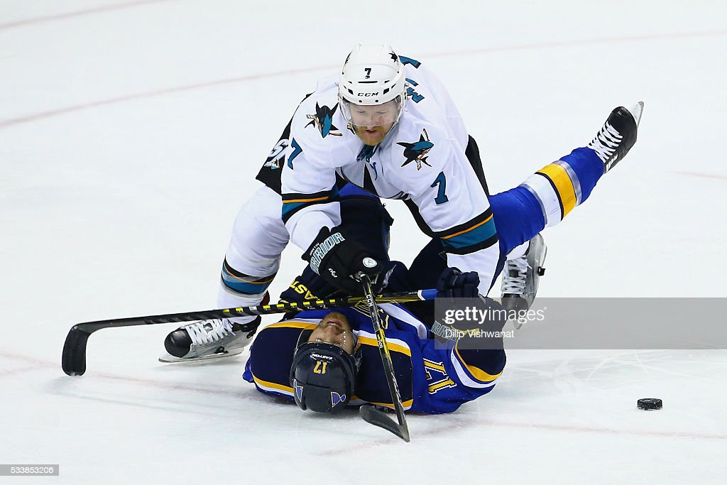 Paul Martin #7 of the San Jose Sharks falls on top of Jaden Schwartz #17 of the St. Louis Blues during the second period in Game Five of the Western Conference Final during the 2016 NHL Stanley Cup Playoffs at Scottrade Center on May 23, 2016 in St Louis, Missouri.