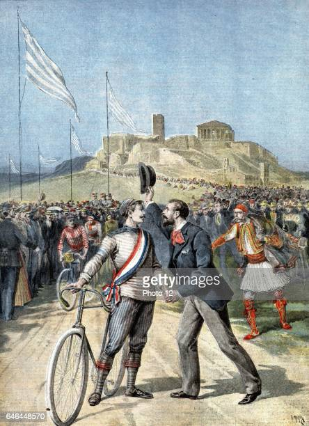 Paul Masson French cyclist being congratulated by a compatriot on winning a cycle race at the first modern Olympiad Athens 1896 Masson won three Gold...