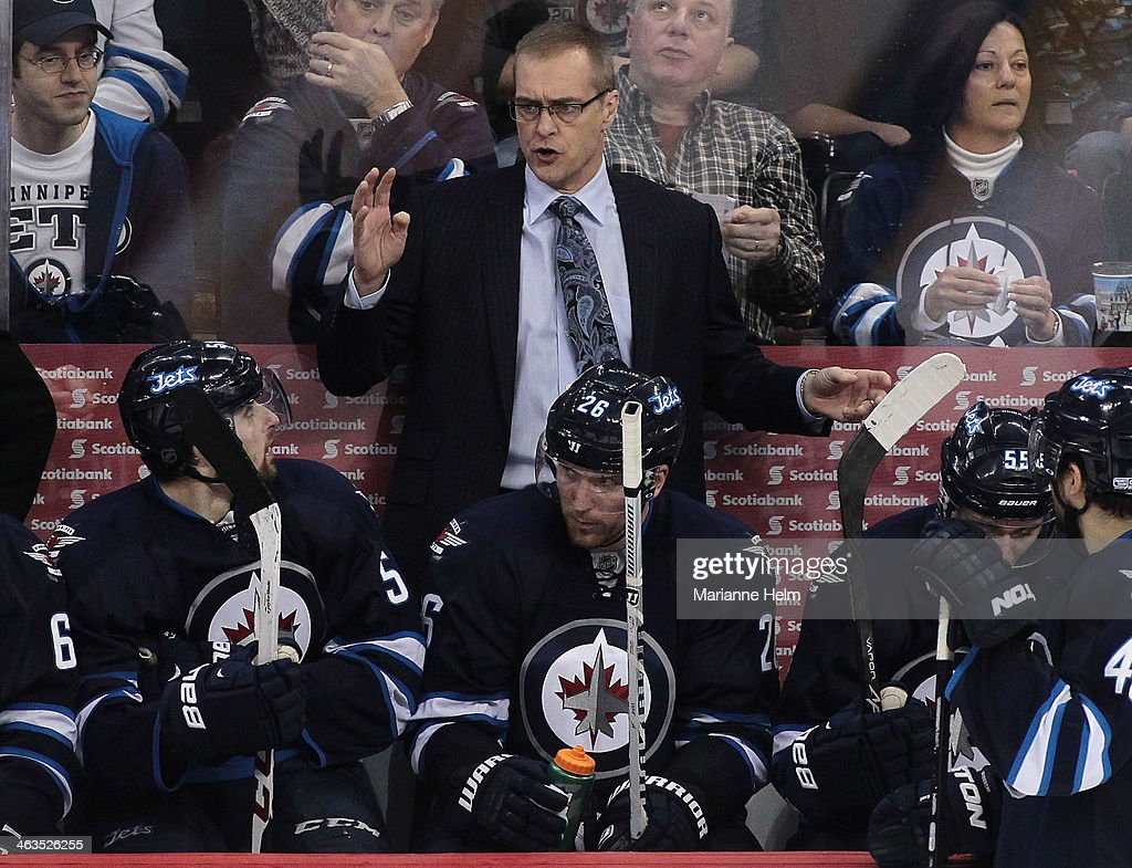 Paul Maurice, head coach of the Winnipeg Jets, talk to his team during third period action in an NHL game against the Edmonton Oilers at the MTS Centre on January 18, 2014 in Winnipeg, Manitoba, Canada.