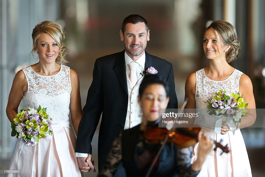 Paul McCarthy, along with flower girl Amanda Wenham (L) and matron of honour Tracey Moloney, arrives for his wedding ceremony at the Museum of New Zealand, Te Papa, on August 19, 2013 in Wellington, New Zealand. Australian gay couple Paul McCarthy and Trent Kandler were flown to Wellington by Tourism New Zealand in a promotion to highlight to Australians that same-sex marriage is legal in New Zealand.
