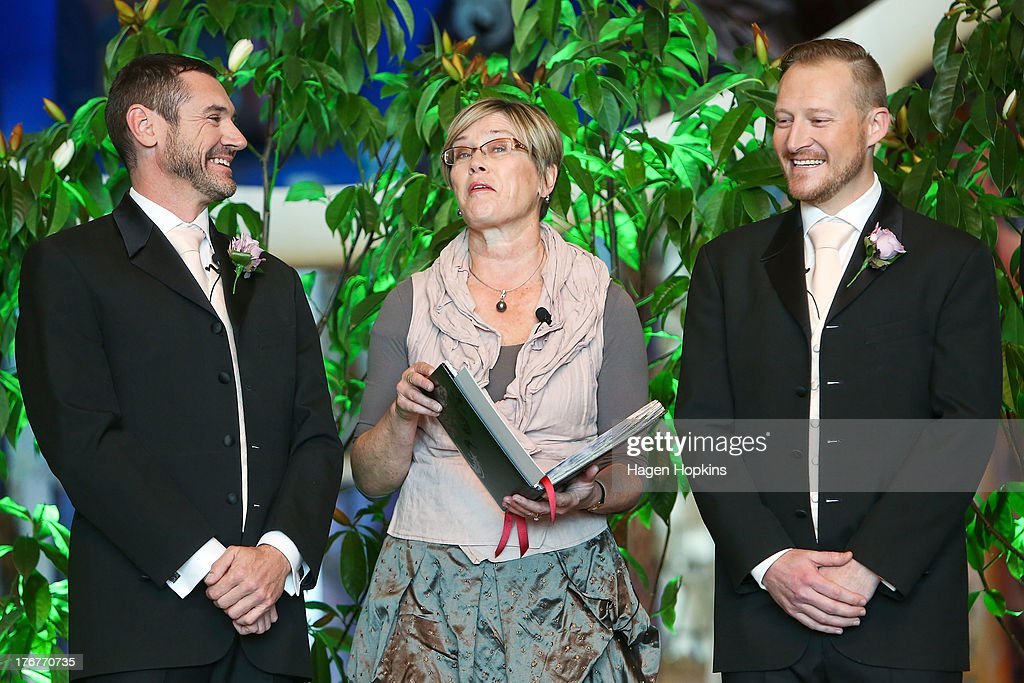 Paul McCarthy (L) and Trent Kandler enjoy a laugh with celebrant Kerry Prendergast during their marriage ceremony at the Museum of New Zealand, Te Papa, on August 19, 2013 in Wellington, New Zealand. Australian gay couple Paul McCarthy and Trent Kandler were flown to Wellington by Tourism New Zealand in a promotion to highlight to Australians that same-sex marriage is legal in New Zealand.
