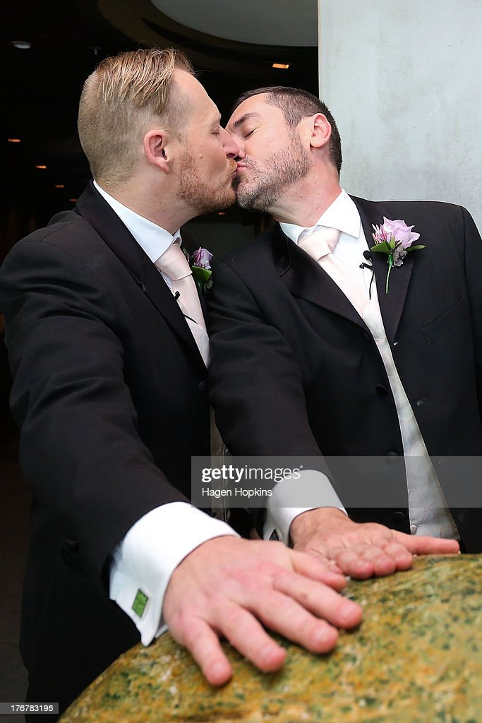Paul McCarthy (R) and Trent Kandler kiss while rubbing a giant greenstone (pounamu) after being married at the Museum of New Zealand, Te Papa, on August 19, 2013 in Wellington, New Zealand. Australian gay couple Paul McCarthy and Trent Kandler were flown to Wellington by Tourism New Zealand in a promotion to highlight to Australians that same-sex marriage is legal in New Zealand.