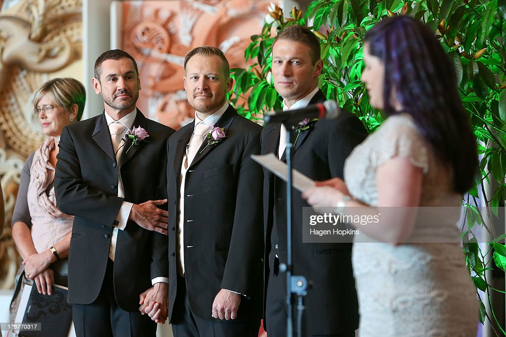 Paul McCarthy (L) and Trent Kandler look on during their marriage ceremony at the Museum of New Zealand, Te Papa, on August 19, 2013 in Wellington, New Zealand. Australian gay couple Paul McCarthy and Trent Kandler were flown to Wellington by Tourism New Zealand in a promotion to highlight to Australians that same-sex marriage is legal in New Zealand.
