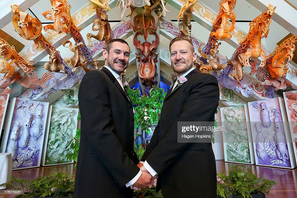 Paul McCarthy (L) and Trent Kandler pose after being married at the Museum of New Zealand, Te Papa, on August 19, 2013 in Wellington, New Zealand. Australian gay couple Paul McCarthy and Trent Kandler were flown to Wellington by Tourism New Zealand in a promotion to highlight to Australians that same-sex marriage is legal in New Zealand.