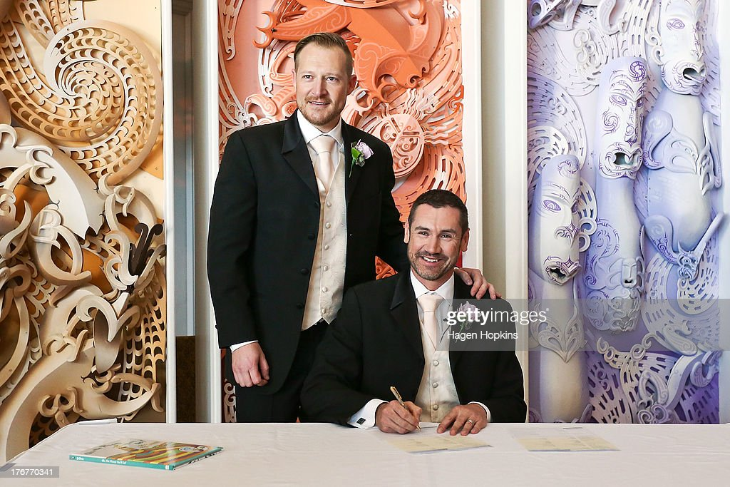 Paul McCarthy (R) and Trent Kandler pose while signing the register during their marriage ceremony at the Museum of New Zealand, Te Papa, on August 19, 2013 in Wellington, New Zealand. Australian gay couple Paul McCarthy and Trent Kandler were flown to Wellington by Tourism New Zealand in a promotion to highlight to Australians that same-sex marriage is legal in New Zealand.