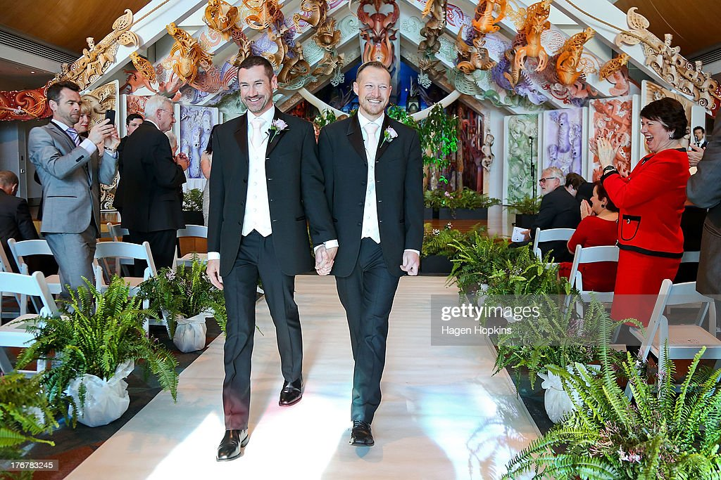 Paul McCarthy (L) and Trent Kandler walk down the aisle after being married at the Museum of New Zealand, Te Papa, on August 19, 2013 in Wellington, New Zealand. Australian gay couple Paul McCarthy and Trent Kandler were flown to Wellington by Tourism New Zealand in a promotion to highlight to Australians that same-sex marriage is legal in New Zealand.
