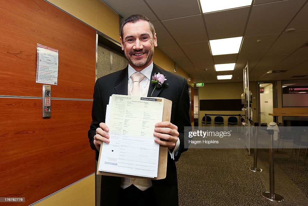 Paul McCarthy picks up his marriage certificate from the Department of Internal Affairs office prior to his wedding ceremony at the Museum of New Zealand, Te Papa, on August 19, 2013 in Wellington, New Zealand. Australian gay couple Paul McCarthy and Trent Kandler were flown to Wellington by Tourism New Zealand in a promotion to highlight to Australians that same-sex marriage is legal in New Zealand.