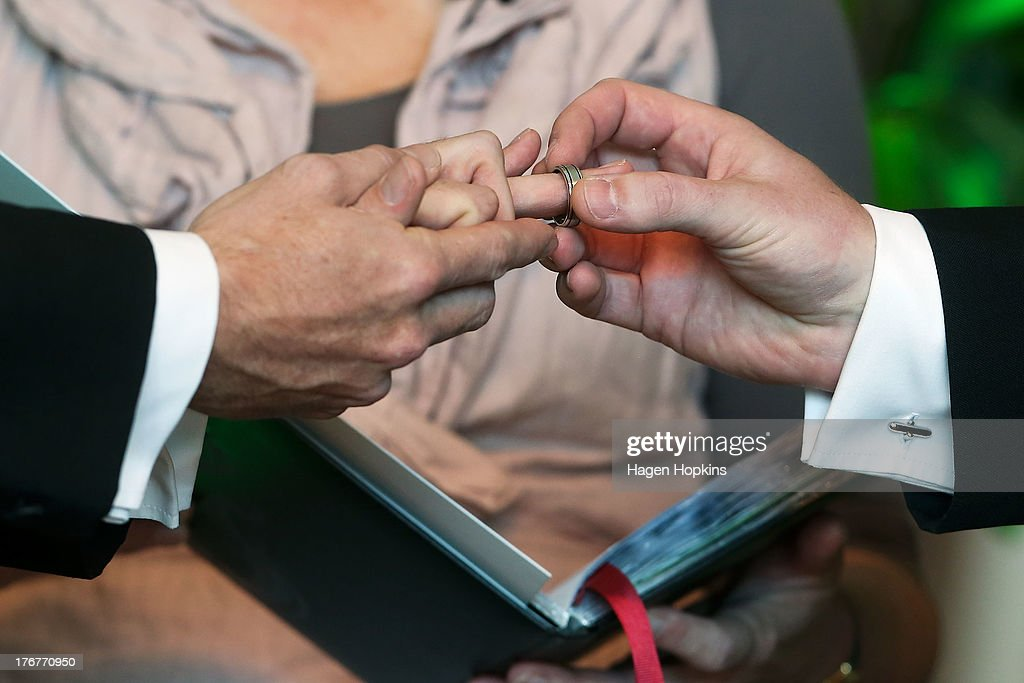 Paul McCarthy receives his wedding ring from Trent Kandler during their marriage ceremony at the Museum of New Zealand, Te Papa, on August 19, 2013 in Wellington, New Zealand. Australian gay couple Paul McCarthy and Trent Kandler were flown to Wellington by Tourism New Zealand in a promotion to highlight to Australians that same-sex marriage is legal in New Zealand.