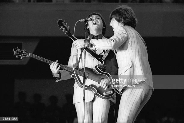 Paul McCartney and George Harrison on stage at Tokyos Budokan Hall during The Beatles Asian tour 1st July 1966
