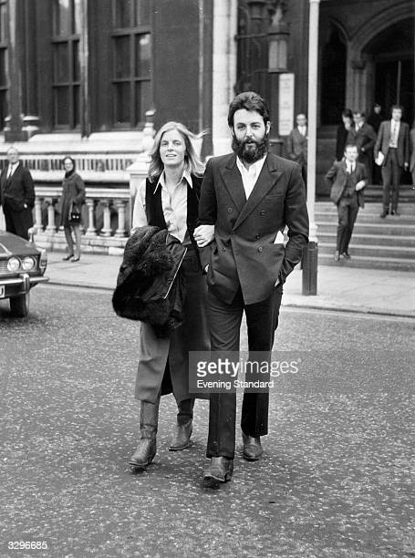 Paul McCartney and his wife Linda outside the Royal Courts of Justice in London 19th February 1971 McCartney is bringing a lawsuit against his former...