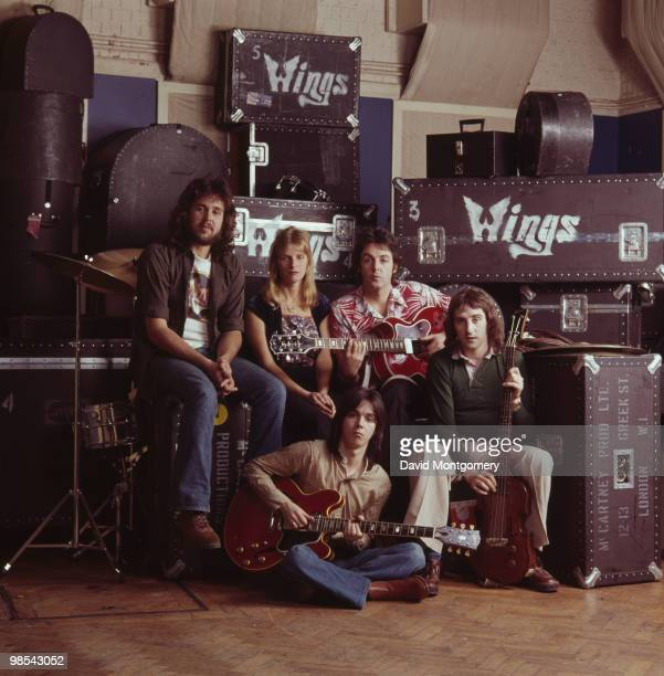 Paul McCartney and his wife Linda with their group Wings circa 1976 From left to right drummer Joe English Linda Paul and Denny Laine with guitarist...