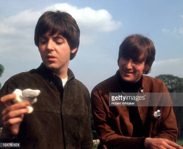 Paul McCartney and John Lennon of the Beatles at Cliveden House in Buckinghamshire during a break in the filming of 'Help' May 1965