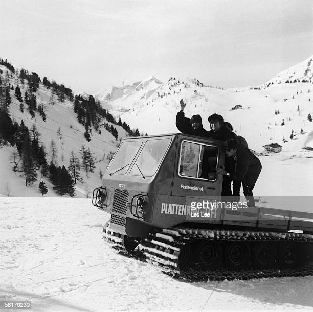 Paul McCartney and John Lennon on a vehicle with caterpillar tracks in the snowy Austrian Alps during the making of the second Beatles film 'Help'...