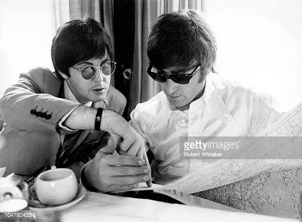 Paul McCartney and John Lennon on board a train to Essen during the German leg of the Beatles' final world tour 25th June 1966 The train had...