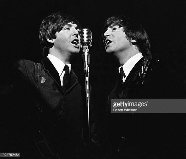 Paul McCartney and John Lennon performing on stage during the Beatles' first US tour 1964