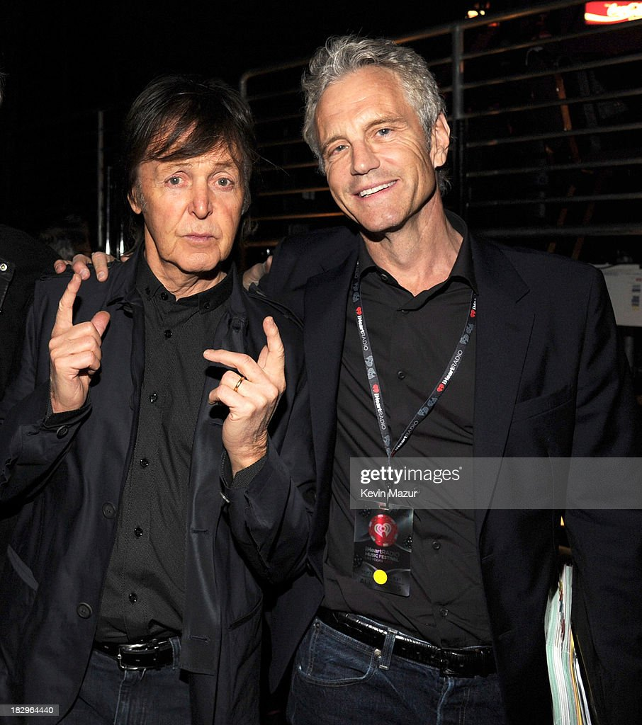 Paul McCartney and John Sykes attend the iHeartRadio Music Festival at the MGM Grand Garden Arena on September 20 2013 in Las Vegas Nevada