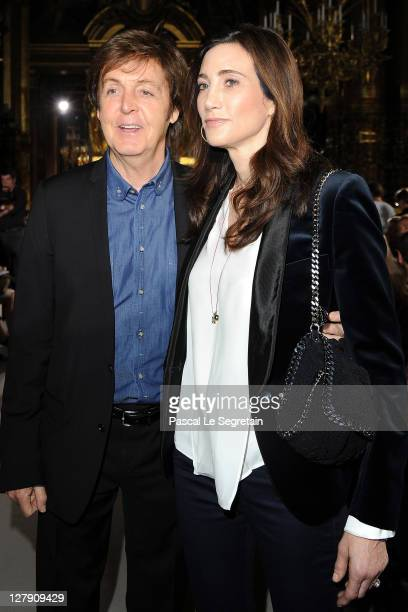 Paul McCartney and Nancy Shevell attend the Stella McCartney Ready to Wear Spring / Summer 2012 show during Paris Fashion Week on October 3 2011 in...