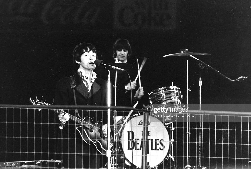 Paul McCartney and Ringo Starr of The Beatles perform during the last concert on their final tour at Candlestick Park San Francisco California August...
