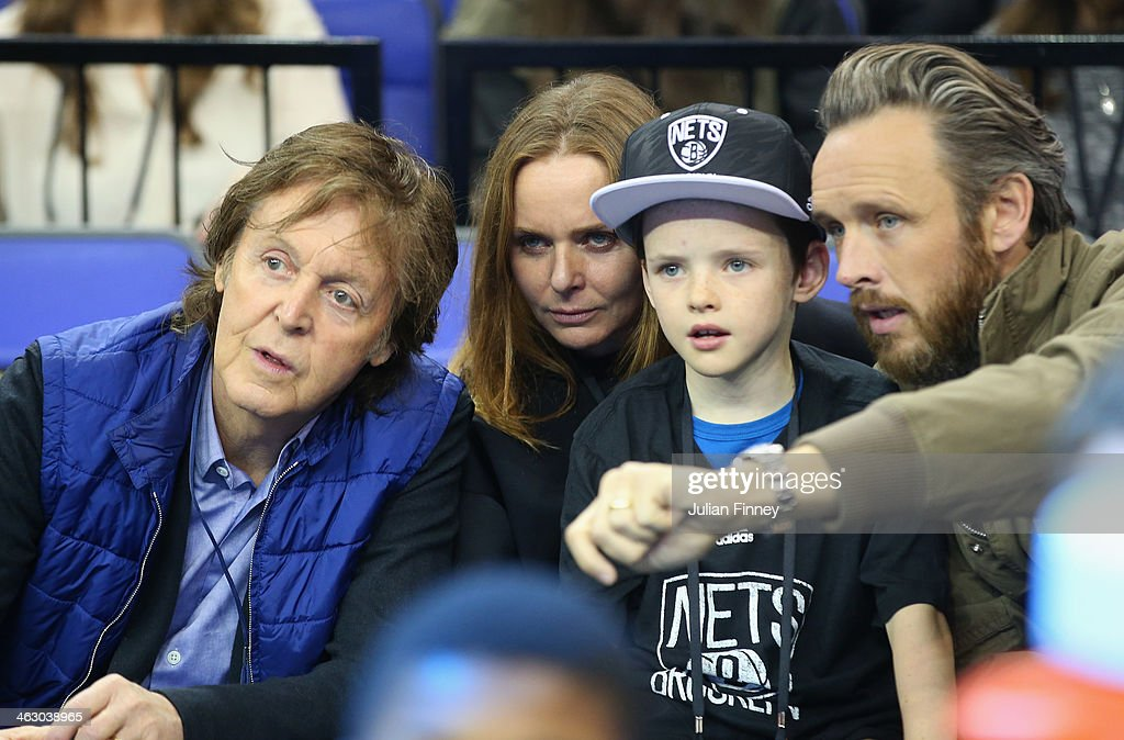 Paul McCartney and Stella McCartney look on during the Eastern Conference NBA match between Brooklyn Nets and Atlanta Hawks at O2 Arena on January 16, 2014 in London, England.