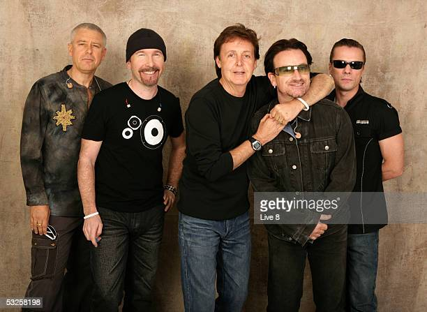 Paul McCartney and U2 pose for a studio portrait backstage at 'Live 8 London' in Hyde Park on July 2 2005 in London England The free concert is one...