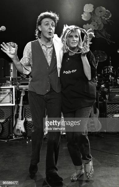 Paul McCartney and wife Linda McCartney pose on stage at the Playhouse Theatre during a press showcase on July 27th 1989 in London