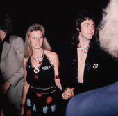 Paul McCartney and wife photographer Linda McCartney as they arrive for the premiere of 'Live And Let Die' for which McCartney's band 'Wings'...
