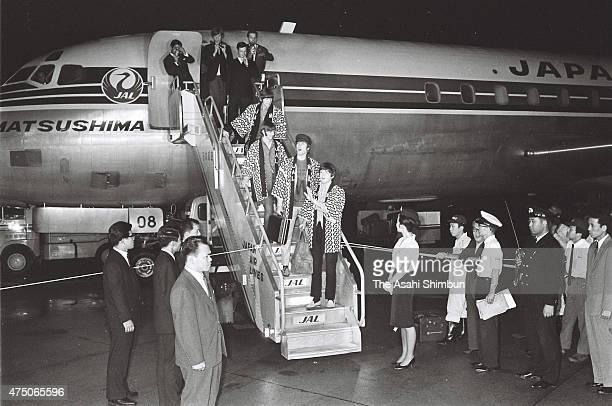 Paul McCartney John Lennon George Harrison and Ringo Starr of the British rock band The Beatles are seen upon arrival at Haneda airport on June 29...