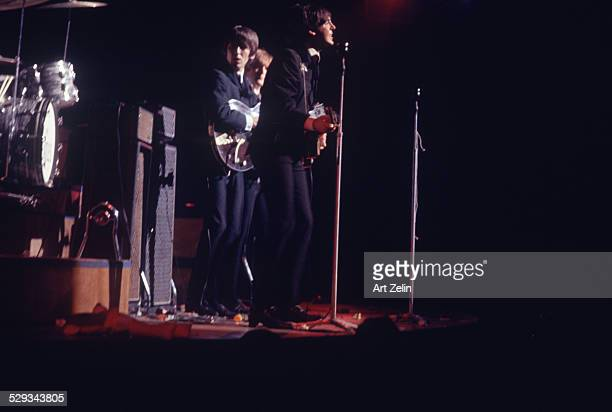 Paul McCartney John Lennon George Harrison in performance at the Paramount Theater Times Square 1964