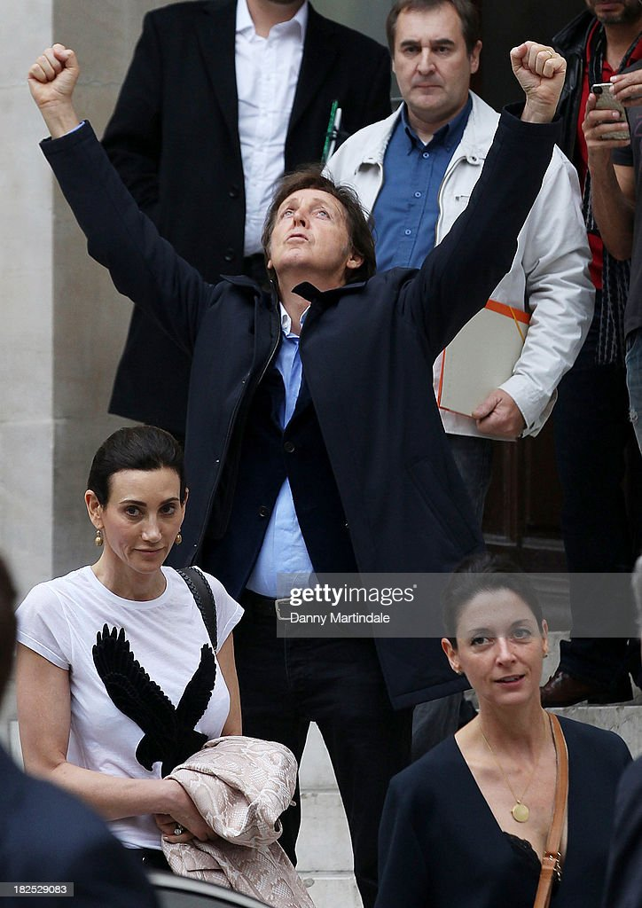 <a gi-track='captionPersonalityLinkClicked' href=/galleries/search?phrase=Paul+McCartney&family=editorial&specificpeople=92298 ng-click='$event.stopPropagation()'>Paul McCartney</a> (punching the air), <a gi-track='captionPersonalityLinkClicked' href=/galleries/search?phrase=Nancy+Shevell&family=editorial&specificpeople=5085391 ng-click='$event.stopPropagation()'>Nancy Shevell</a> and <a gi-track='captionPersonalityLinkClicked' href=/galleries/search?phrase=Mary+McCartney&family=editorial&specificpeople=208098 ng-click='$event.stopPropagation()'>Mary McCartney</a> are seen leaving the Stella McCartney show at L'Opera de Paris during Paris Fashion Week Womenswear Spring/Summer 2014 on September 30, 2013 in Paris, France.