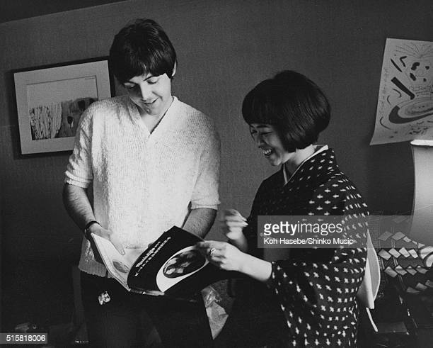 Paul McCartney of the Beatles signs an autograph during an interview with journalist Rumi Hoshika for Japanese music magazine 'Music Life' Tokyo...