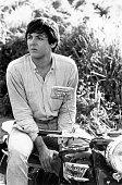 Paul McCartney of The Beatles sitting astride his motor bike 1965 Original Publication People Disc HU0058