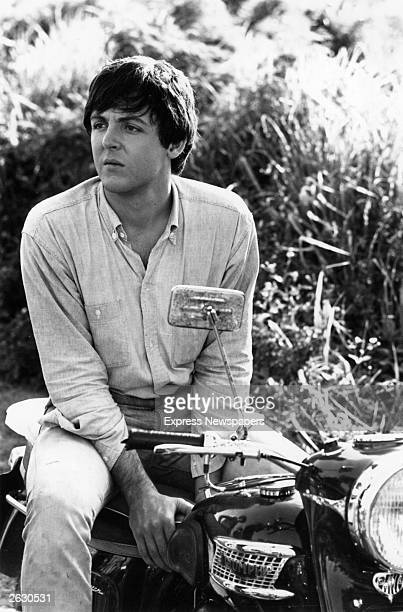 Paul McCartney of The Beatles sitting astride his motor bike 1965 Original Publication People Disc HU0058