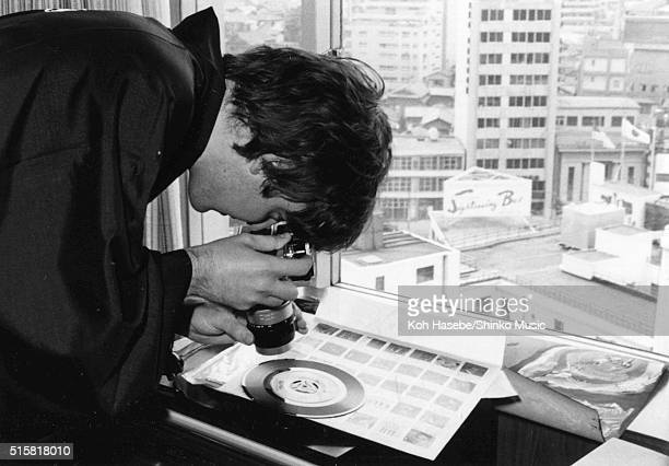 Paul McCartney of the Beatles tests out a camera during an interview for Japanese music magazine 'Music Life' Tokyo Hilton Hotel Japan July 2 1966