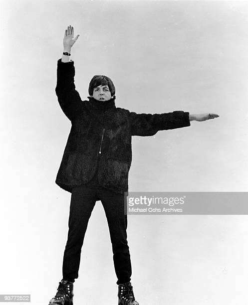 Paul McCartney of the rock and roll band 'The Beatles' poses for a photo in the snow in March 1965 in Obertauern Austria during a break from filming...
