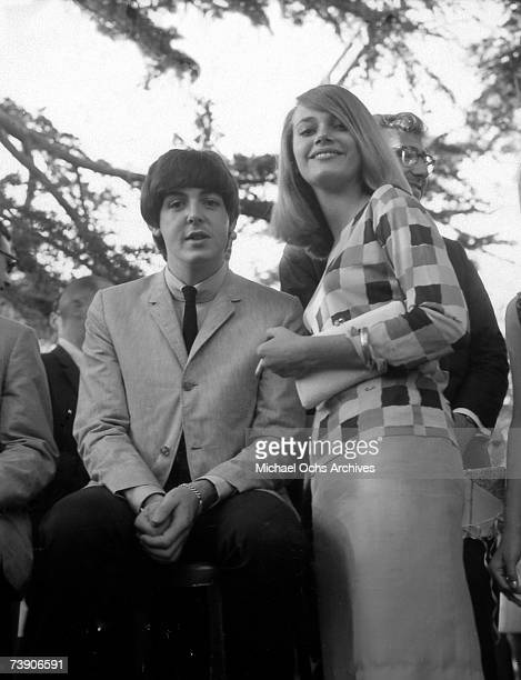Paul McCartney of the rock and roll band 'The Beatles' poses for a portrait with actress Peggy Lipton on August 24 1964 in Los Angeles California