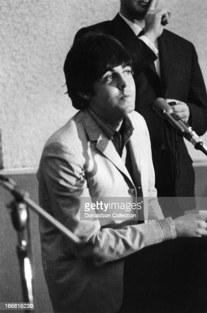 Paul McCartney of the rock and roll group 'The Beatles' at a press conference for the release of their album 'Help' at the Capitol Records Tower Los...