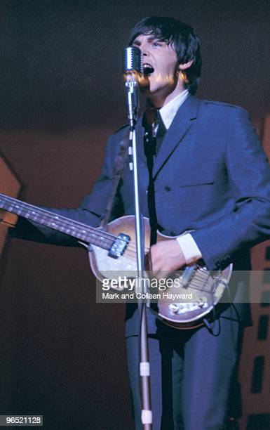 Paul McCartney performing with The Beatles during their American tour August 1965
