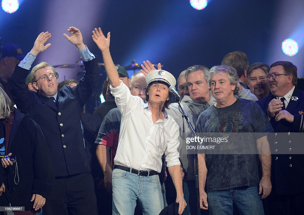 Paul McCartney (C) performs on stage during the finale of '12-12-12 ~ The Concert For Sandy Relief' December 12, 2012 at Madison Square Garden in New York.