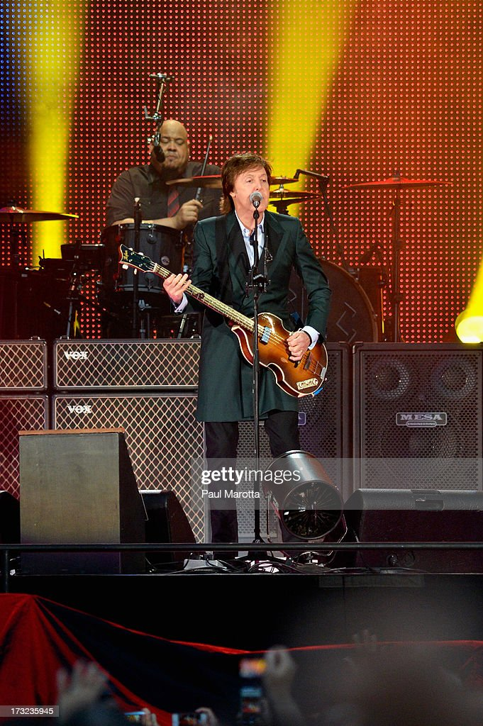 <a gi-track='captionPersonalityLinkClicked' href=/galleries/search?phrase=Paul+McCartney&family=editorial&specificpeople=92298 ng-click='$event.stopPropagation()'>Paul McCartney</a> performs to a sold-out Fenway Park audience of 36,064 on July 9, 2013 in Boston, Massachusetts. This figure sets a new Fenway Park concert attendance record and breaks McCartney's personal Fenway Park concert attendance record set in 2009.