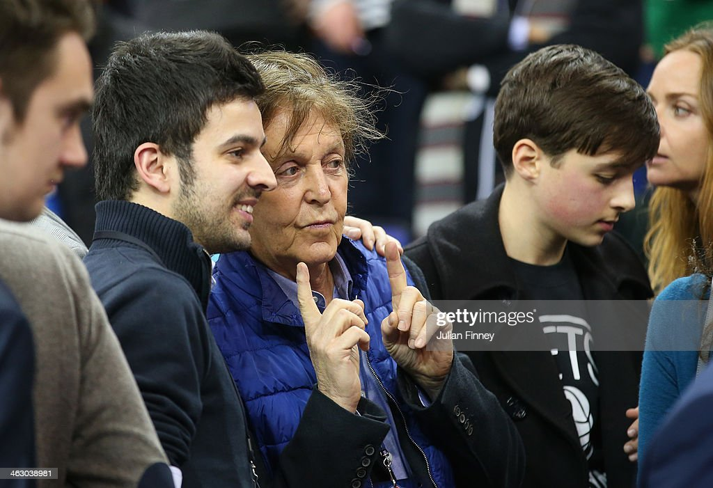 Paul McCartney smiles for a photo during the Eastern Conference NBA match between Brooklyn Nets and Atlanta Hawks at O2 Arena on January 16, 2014 in London, England.