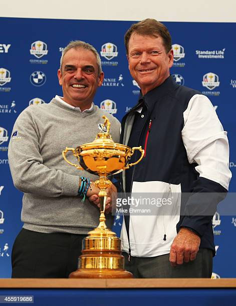 Paul McGinley Captain of the Europe shakes hands with Tom Watson Captain of the United States team during a press conference ahead of the 2014 Ryder...