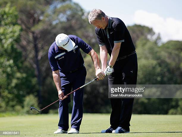 Paul McGinley of Ireland gives swing advice or tips to Former Manchester United Manager David Moyes during the Open de Espana ProAm at PGA Catalunya...