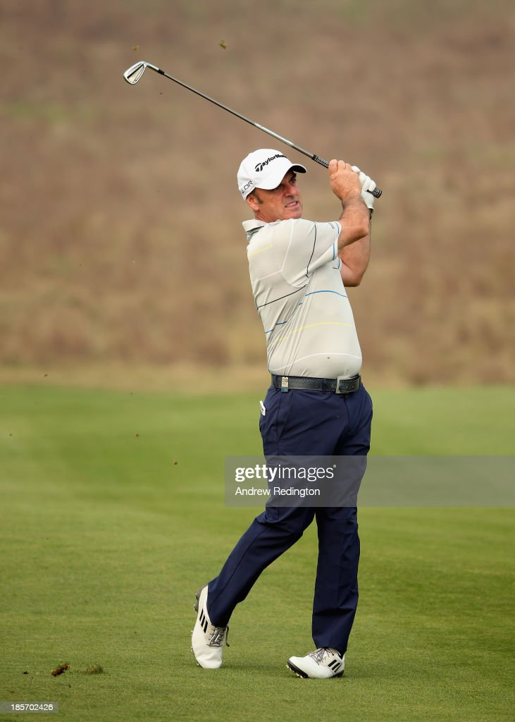 <a gi-track='captionPersonalityLinkClicked' href=/galleries/search?phrase=Paul+McGinley&family=editorial&specificpeople=178983 ng-click='$event.stopPropagation()'>Paul McGinley</a> of Ireland in action during the first round of the BMW Masters at Lake Malaren Golf Club on October 24, 2013 in Shanghai, China.
