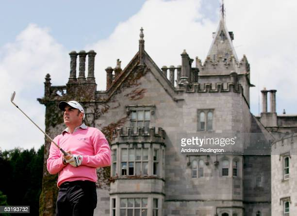 Paul McGinley of Ireland tees off on the 16th hole with The Manor House in the background during the first round of the JP McManus Invitational ProAm...