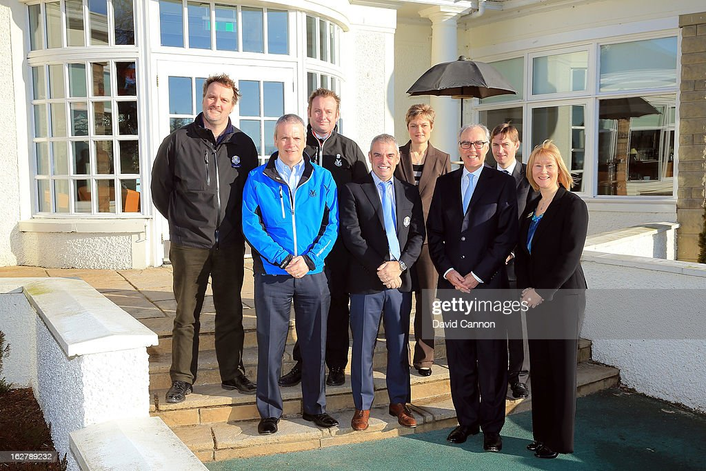 Paul McGinley of Ireland, the 2014 European Ryder Cup Team Captain (front row, 2nd L) and Patrick Elsmie, Managing Director of the Gleneagles Hotel (front row, 2nd R) and hotel staff members pose outside the golf clubhouse at the Gleneagles Hotel venue for the 2014 Ryder Cup Matches on February 27, 2013 in Auchterarder, Scotland.