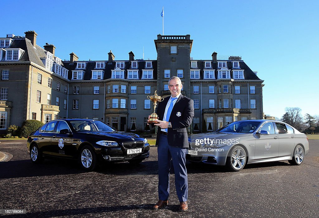 Paul McGinley of Ireland, the 2014 European Ryder Cup Team Captain poses with the Ryder Cup in front of the BMW official cars of the Ryder Cup in front of the Gleneagles Hotel venue for the 2014 Ryder Cup Matches on February 27, 2013 in Auchterarder, Scotland.