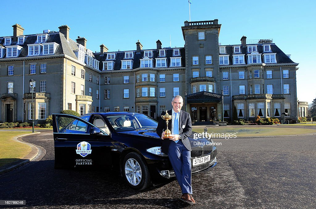 Paul McGinley of Ireland, the 2014 European Ryder Cup Team Captain poses with the Ryder Cup with one of the BMW official cars of the Ryder Cup in front of the Gleneagles Hotel venue for the 2014 Ryder Cup Matches on February 27, 2013 in Auchterarder, Scotland.