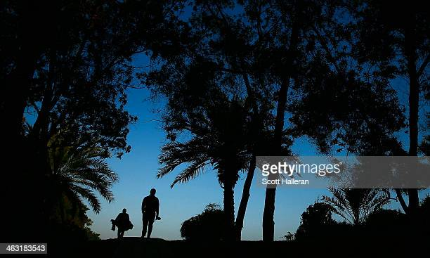 Paul McGinley of Ireland walks with his caddie to the 14th hole during the second round of the Abu Dhabi HSBC Golf Championship at the Abu Dhabi Golf...