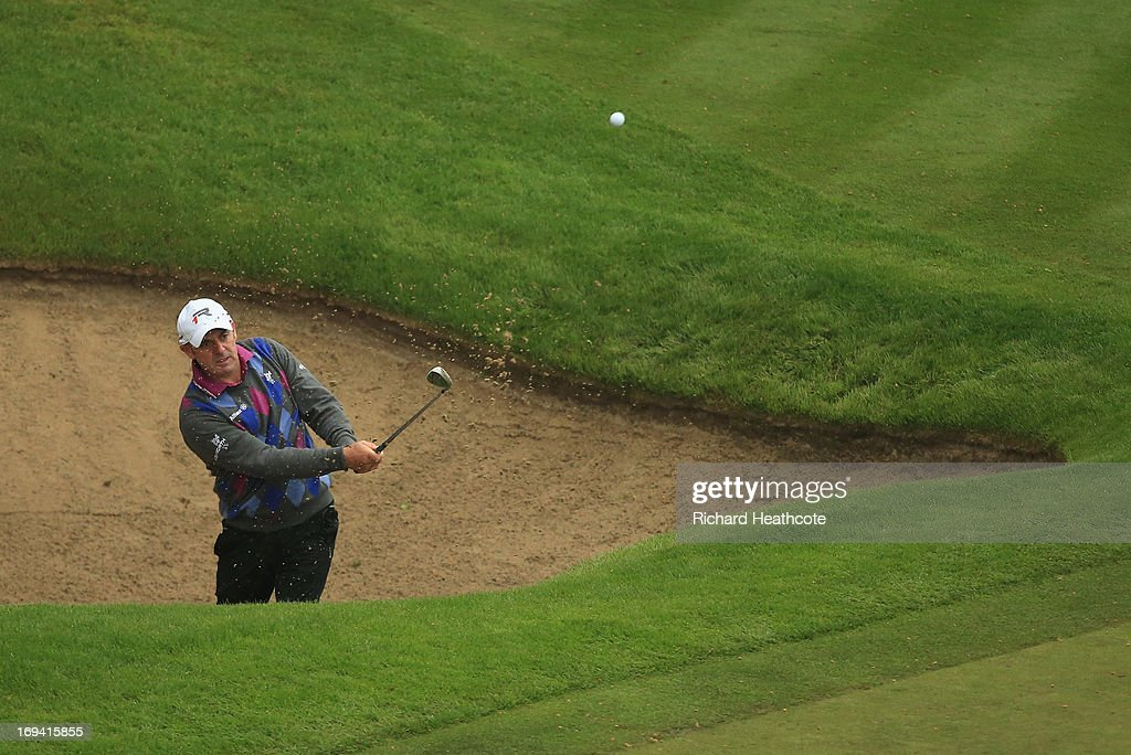 <a gi-track='captionPersonalityLinkClicked' href=/galleries/search?phrase=Paul+McGinley&family=editorial&specificpeople=178983 ng-click='$event.stopPropagation()'>Paul McGinley</a> of Republic of Ireland hits from a bunker on the 18th hole during the second round of the BMW PGA Championship on the West Course at Wentworth on May 24, 2013 in Virginia Water, England.