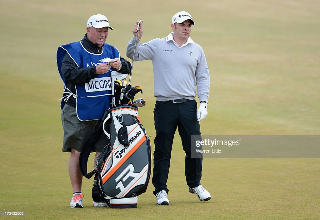 Paul McGinley of Republic of Ireland pulls a club on the 1st hole during the final round of the Aberdeen Asset Management Scottish Open at Castle Stuart Golf Links on July 14, 2013 in Inverness, Scotland.